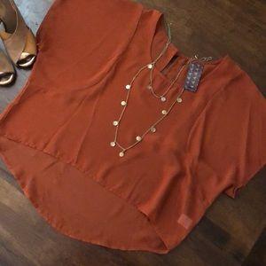 wallpapHER burnt orange blouse from Nordstrom.